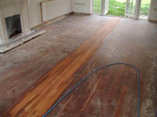 scuffed and damaged wooden floor during restoration